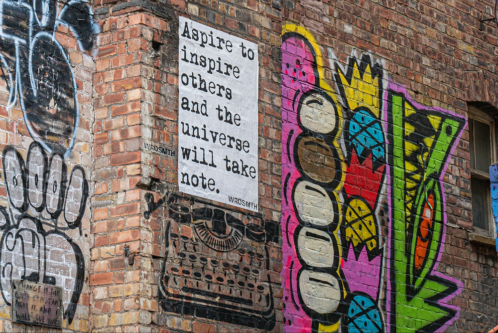 photo of graffiti reading aspire to inspire others and the universe will take note