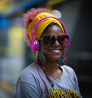 A woman listening to a podcast on  headphones