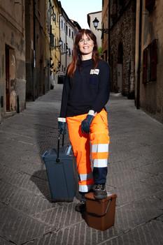 Romina, door-to-door collecting. old town center, Piombino (LI).