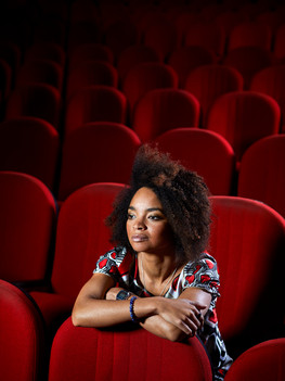 """Rosanna Sparapano, 36 years old, is an actress with Italian and Congolese origins. Born in Kinshasa however moved to Milan when still a little girl with her parents, who unfortunately passed shortly after. Raised by her paternal uncle, her passion for theatre bloomed by chance; at thirteen years old she replaces the protagonist of a comedy and from that instance on theatre became her aspiration. In 2002 she completes the first step into her professional journey by graduating from the """"Piccolo Teatro di Milano""""."""