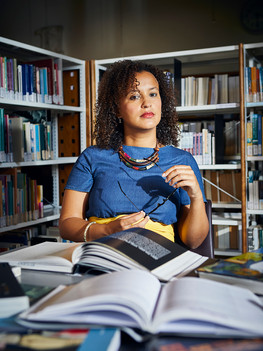 """Angelica Pesarini, 40 years old, is a sociology professor at the New York University of Florence. Born in Rome her cultural heritage is tied to the former Italian colonization in Eritrea and Somalia. After achieving her specialisation in London she is currently studying anthropology at the Sapienza University of Rome. Angelica is the first black professor of sociology in Italy and indeed the only one teaching a course on race: """"Black Italia""""."""