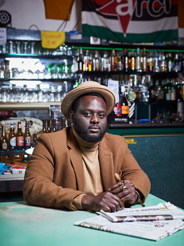 """Tommy Kuti, 29 years old, Italian rapper of Nigerian origins. Raised in Castiglione delle Stiviere  in the neighbourhood known as the """"5 continents"""". He vividly recalls when a schoolteacher held a class on African history and culture: """"all us that were clearly different from our peers felt appreciated and accepted"""". His singles describe Italy today; through sharp rhymes and critiques he ironically recounts about police, racism and fake news."""