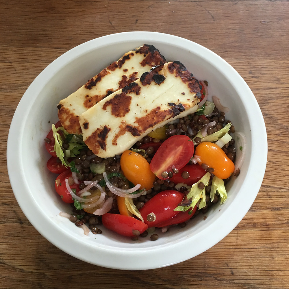 Puy lentil salad with tomatoes, celery and halloumi
