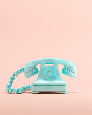 Blue vintage telephone on pink pastel co