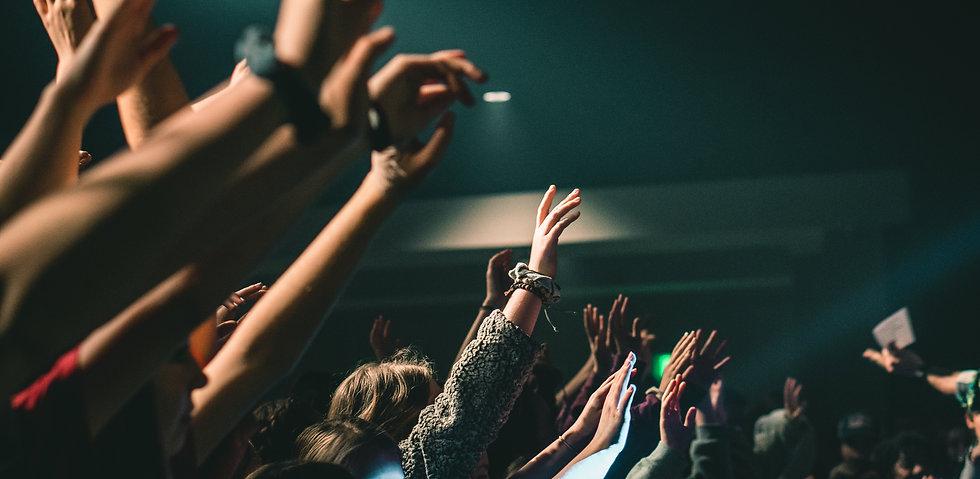 Hands Raised In Worship.jpg