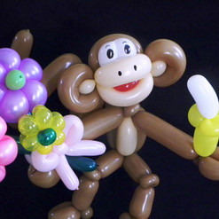 Monkey with flowers and banana balloon gift