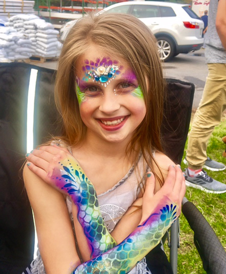 Glitter arm painting and face paint
