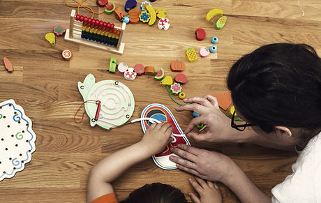 early-childhood-educator-with-toys-and-c