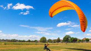 Paraglider testing his chute...