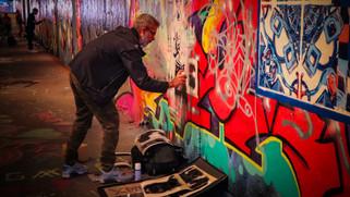 """Stencil Street Artist """"XLVII"""" at work"""