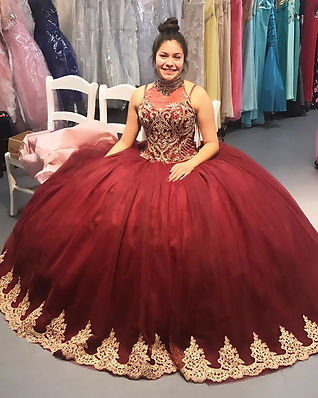 Burgundy tull quinceanera dress and gold dress