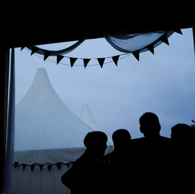 Sunset wedding photo marquee
