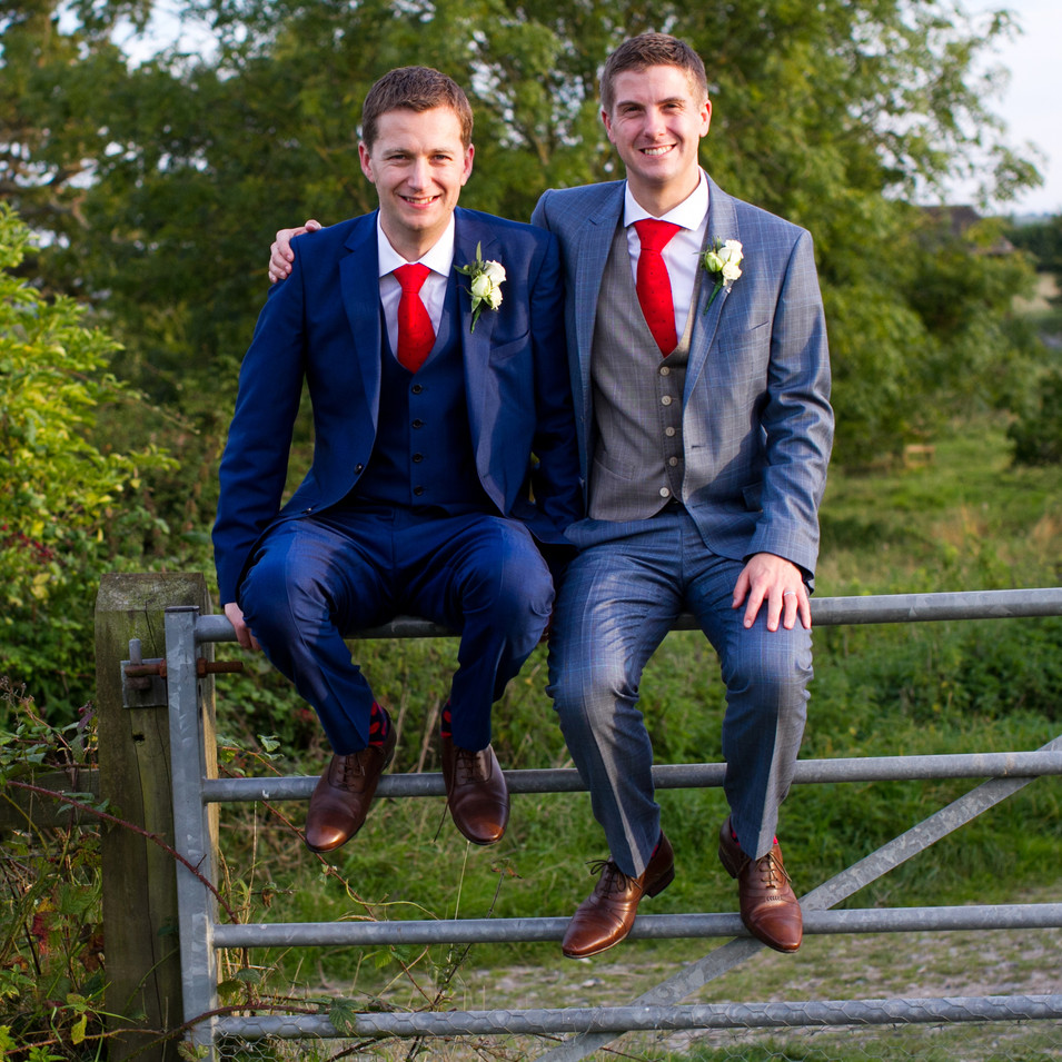 Two grooms at country wedding