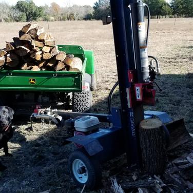 Our 22Ton log splitter and john deere gator on a job