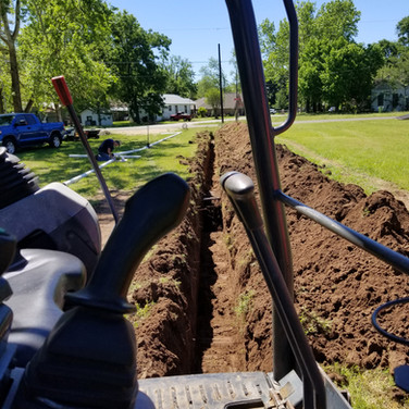 Digging a septic line trench