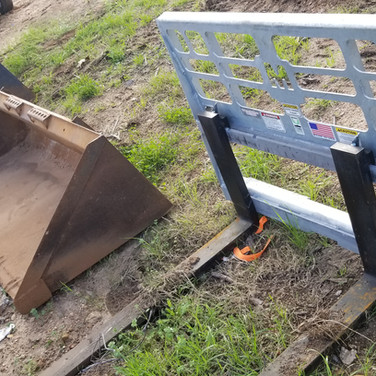 Skid steer buckets and pallet forks