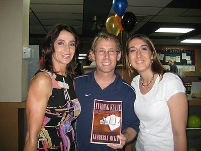 BART CONNER & NADIA COMANECI WITH KIMBERLY MCKAY AND HER BOOK