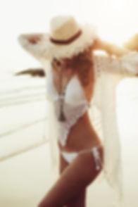 tan woman in bikini on beach