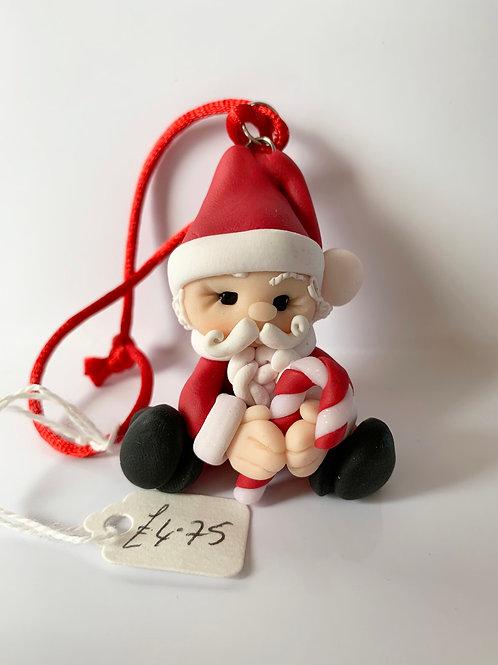 Santa holding a Candy Cane