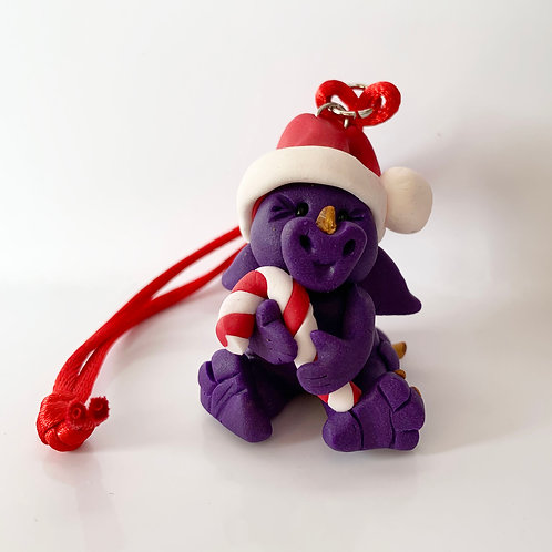 Purple Dragon (holding a candy cane)