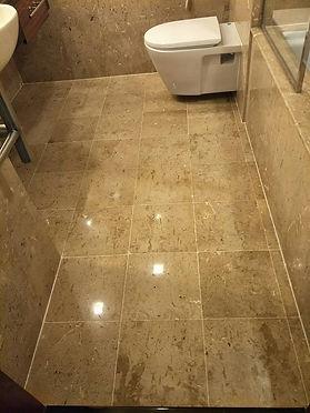 Dirty old bathroom marble floor after ne