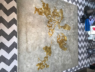 Really dirty white and gold rug before d