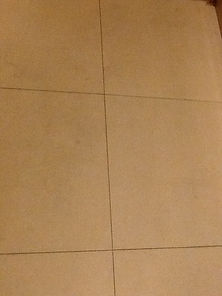 Dirty, dull and old grouting in floor be
