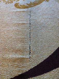 Water damage to carpet causing wrinkling