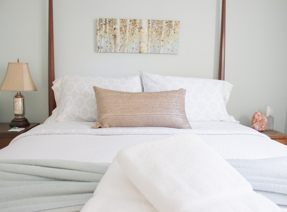 The bedroom is calm and serene, a welcome oasis at the end of the day.