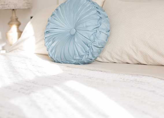 Our bed has several sets of seasonal bedding, but all are soft, cozy, and opulent.