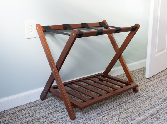 Two luggage racks to store your suitcases, and a closet with hangers, extra blankets/towels, and a full sized iron.