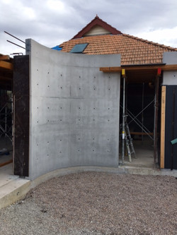 off form concrete curved wall