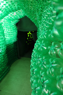 Life-sized installation with 3000 plastic bottles and black eva sheets  that evoked the emotion of 'Joy'.