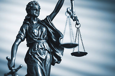 figure-of-justice-holding-scales-and-a-s