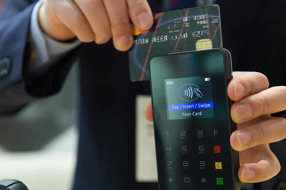 Swiping credit card using a payment processing machine