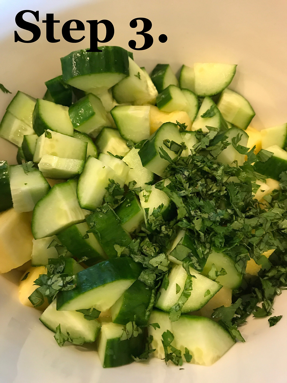 Add cilantro to cucumber and pineapple