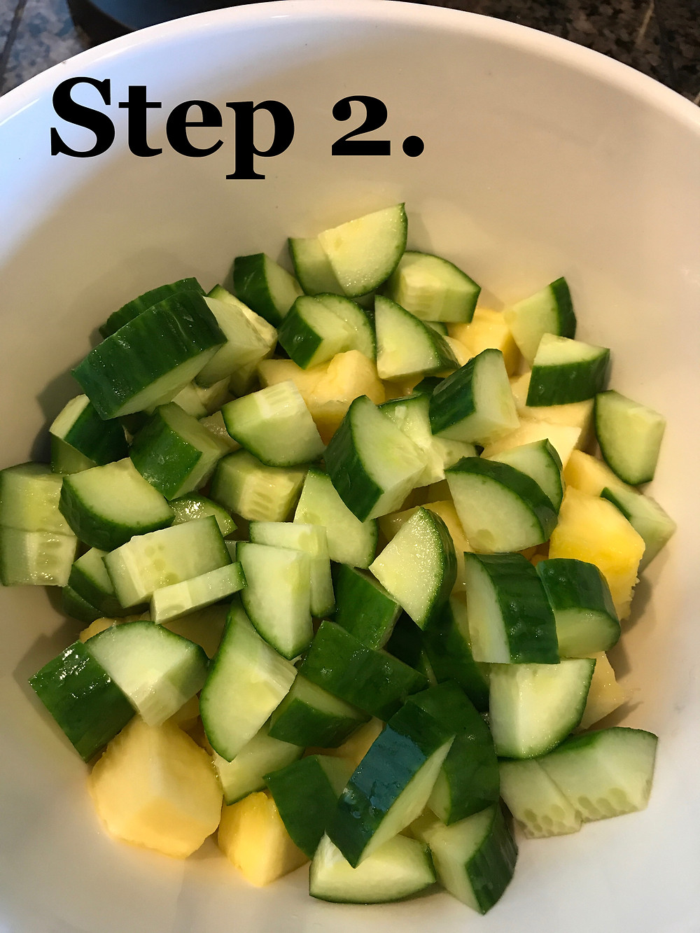 Add sliced cucumber to sliced pineapple