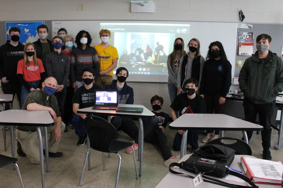During the COVID-19 pandemic, high school students pose for a picture with their new peers in Iran through Skype.