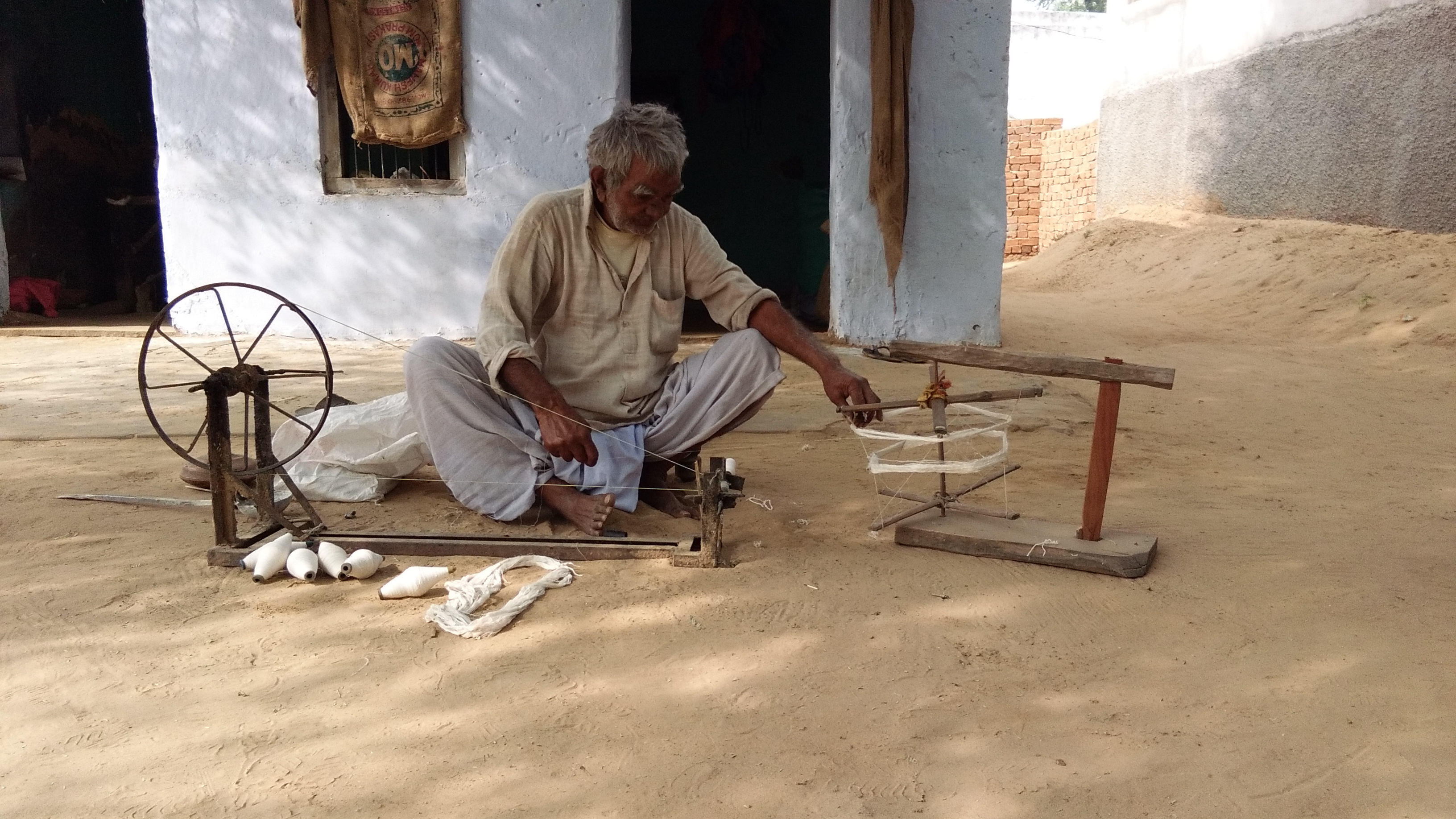 An Old Man Spinning Cotton
