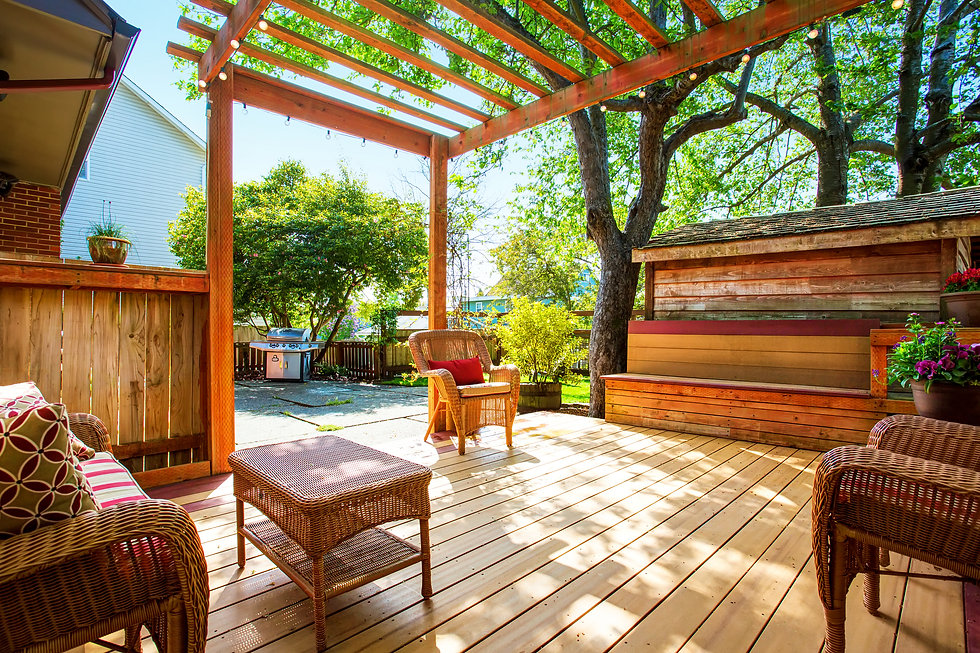 Backyard Deck With Wicker Furniture And Pergola..jpg