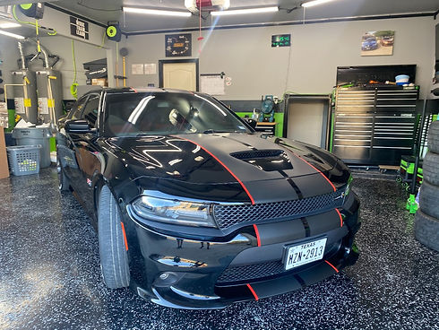 black Dodge Charger with vinyl stripes