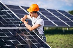 man-worker-firld-by-solar-panels.jpg