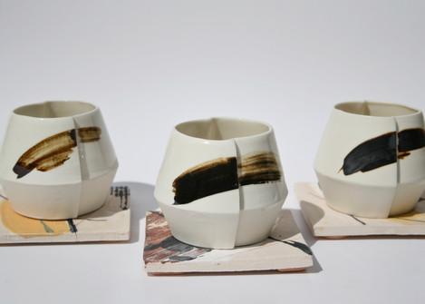 Slip Cast Porcelain Cups on Coasters