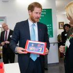 Prince Harry receives Mildmay's Christmas card, signed by everyone he met on his visit.