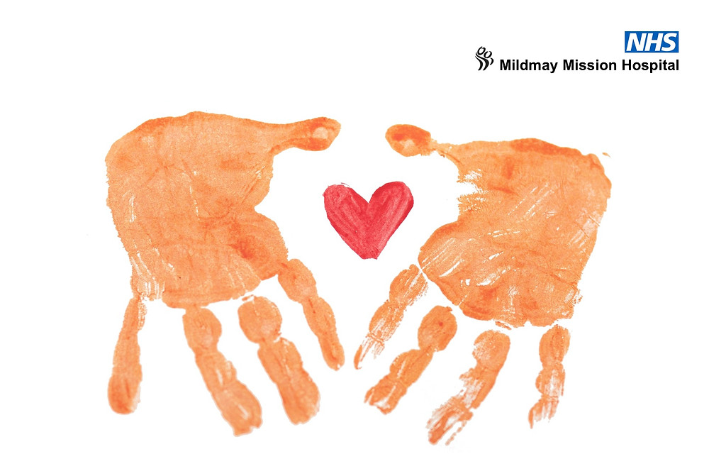 Child's hand prints and red love heart