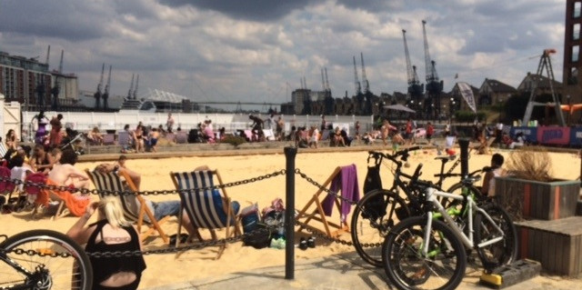 An urban beach in East London plays host to Mildmay' summer outing for Day Therapy clients