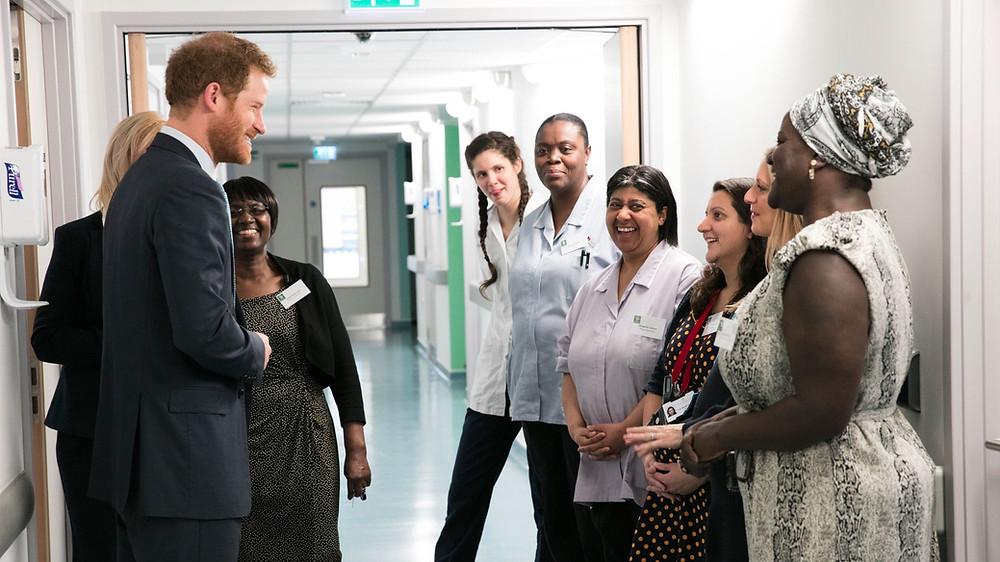 Prince Harry chatting with Mildmay staff