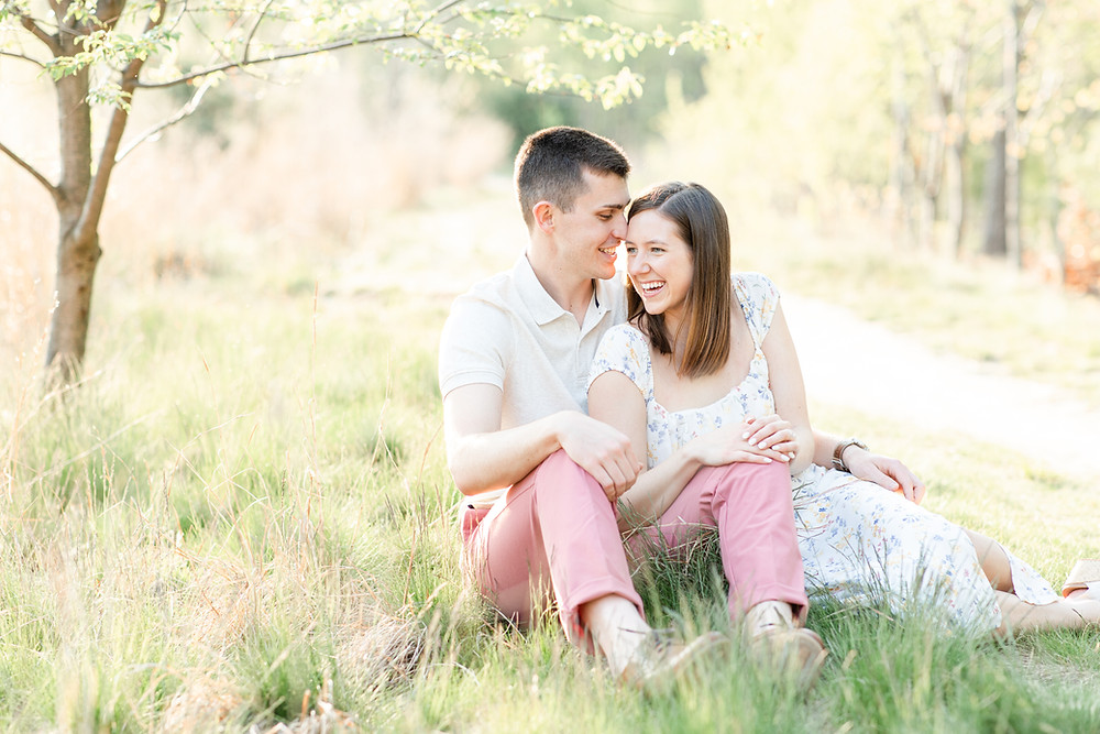 Josh and Andrea wedding photography husband and wife photographer team michigan engagement pictures session photo shoot fiance Riley Trails sitting laughing