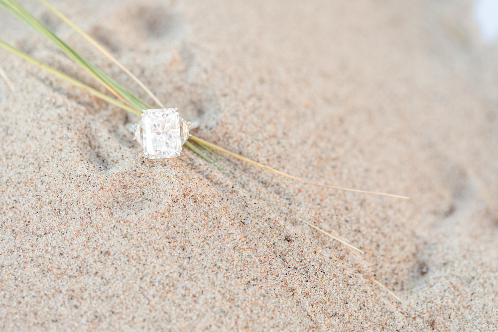 Engagement ring in the sand South Haven Beach Michigan