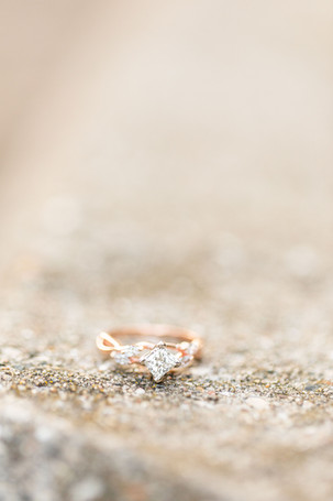 Engagement ring on concrete Tunnel Park Beach Holland Michigan
